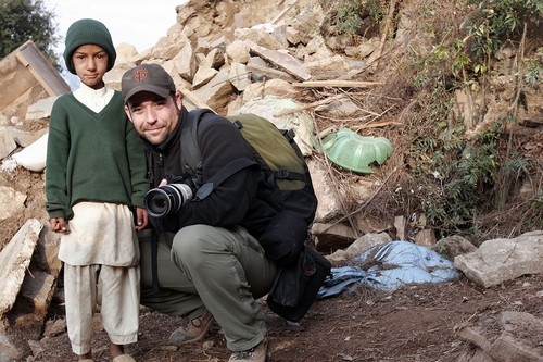 Thomas poses with a young Pakistani boy he befriended while on assignment covering the massive 2005 earthquake in the Kashmir Region of South Asia. Thomas was honored with the 2005 Picture of the Year by Editor & Publisher Magazine for one of his images from his picture series.